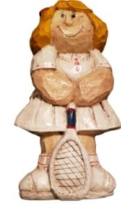 Vintage wood crafted girl tennis player